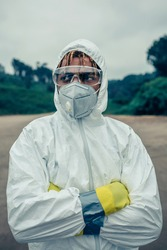 Young man with bacteriological protection suit and protective mask