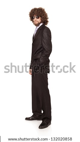 young man with beard and afro style hair wearing a suit and sunglasses looking at camera isolated on white
