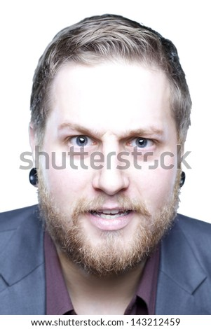 Young man with beard showing emotion up close