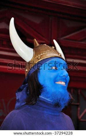 Young man with blue mask on his face