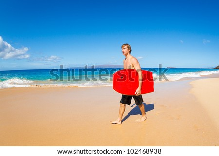 Young Man with Boogie Board at the Beach