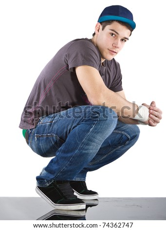Young man with breakdancing clothes isolated over white background.