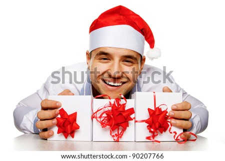 Young man with christmas gifts, isolated on white