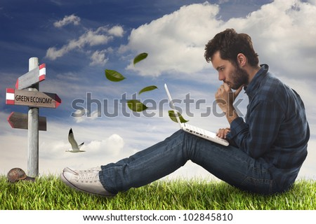 young man with computer in the garden