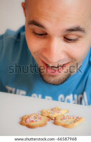 Young man with cookies