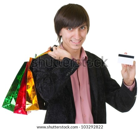 Young man with credit card and shopping bags