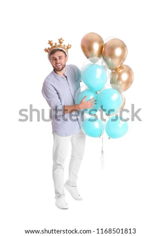 Young man with crown and air balloons on white background #1168501813