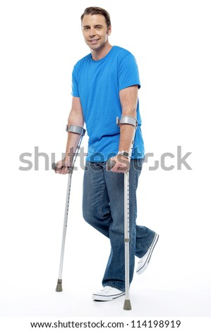 Young man with crutches trying to walk. Accidental case