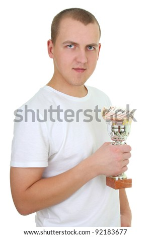 young man with cup of money over white