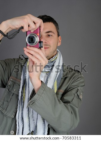 Young man with digital photo camera. isolated on white background