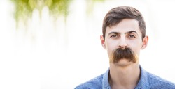Young man with fake mustaches. Dental health concept.