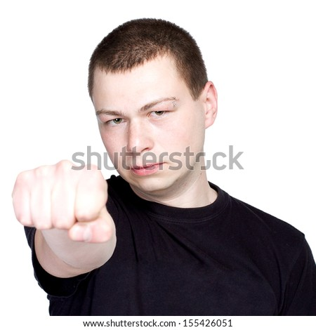Young man with fist - an attitude, fine art portrait