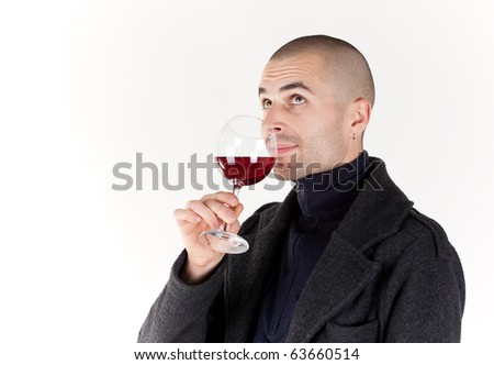 Young man with glass of red win