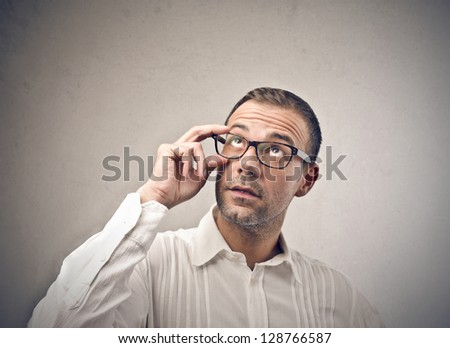 young man with glasses looking up - stock photo