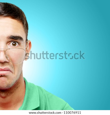 Young man with glasses over light blue gradient background