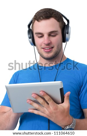 Young man with headphones and blue t-shirt working on a tablet pc