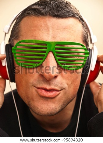 Young man with headphones enjoying music