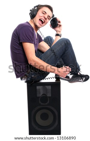 Young man with headphones, seating in a speaker, isolated in white background - stock photo