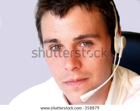 Young man with headset ready to be of assistance