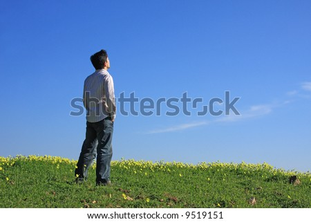 Young man with his hand on the pocket enjoying the nature