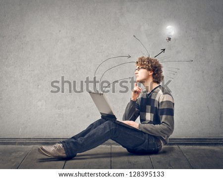 young man with laptop has an idea