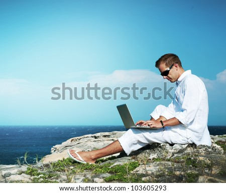 Young Man with Laptop Outdoor
