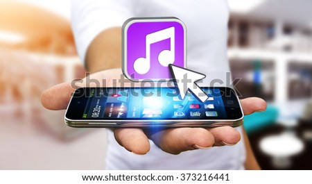 Young man with modern mobile phone in his hand using modern music application #373216441