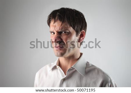 Young man with nauseous expression
