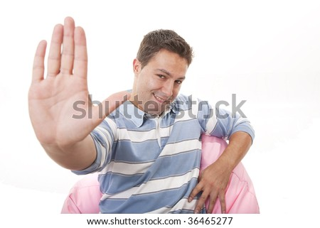 young man with open hand making stop