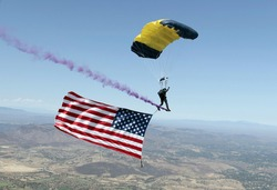 Young man with parachute flying with American Flag - Close up Portrait