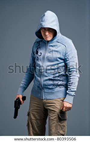 Young man with pistol