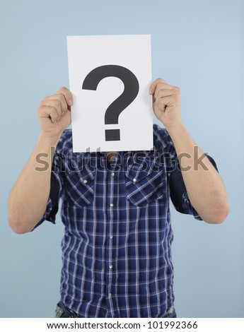 Young man with question mark - stock photo