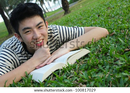 Young man with reading the book