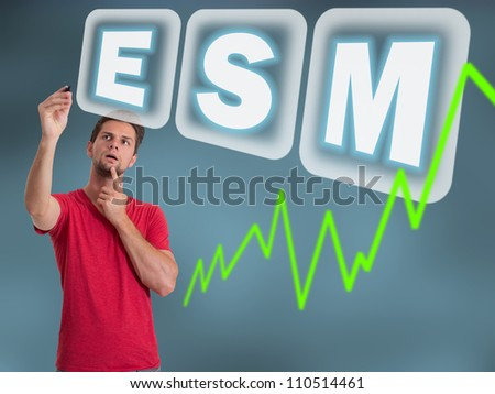Young man with red t-shirt writing ESM