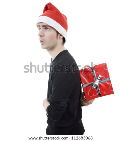 young man with santa hat holding a gift, isolated
