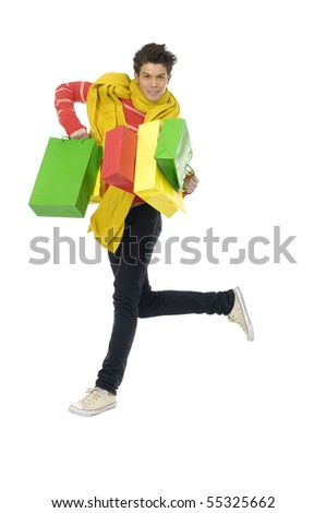 Young man with shopping bag jumping