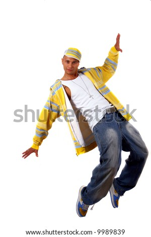Young Man With Style Young man with clothes in hip-hop style showing a dance move while jumping over pure white background.