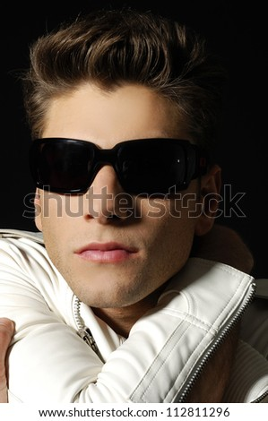 young man with sunglasses portrait, studio shot