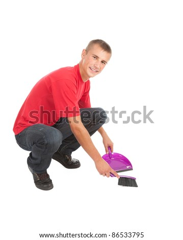 young man with sweep brush and dustpan