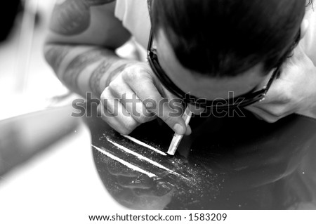 stock-photo-young-man-with-tattoo-sniffi
