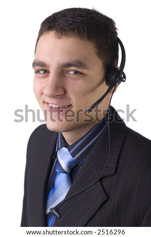 Young man with telephone headset, isolated on white background in studio