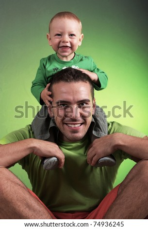Young man with the child up on shoulder