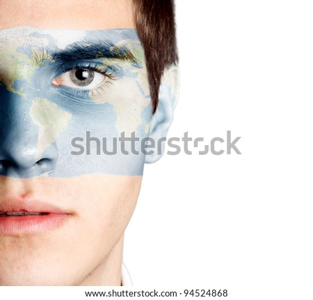 Young man with the world painted on the face
