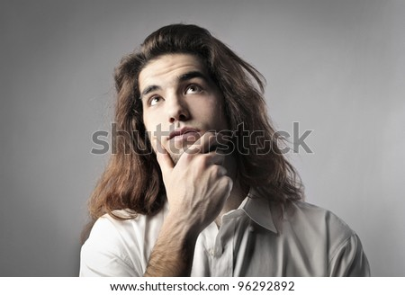 Young man with thoughtful expression