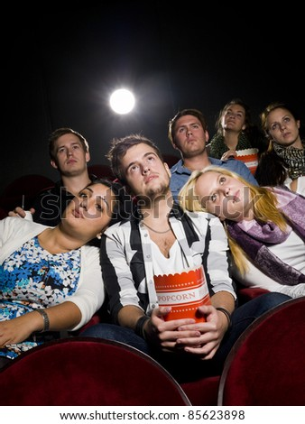 Young man with two women at the movie theater