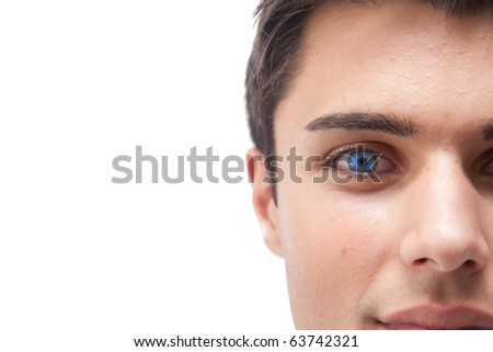 Young man with vivid blue eye macro isolated on white