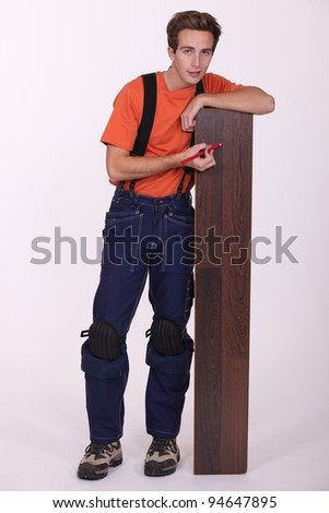 Young man with wood flooring