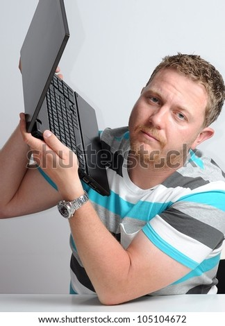 Young man work with laptop.