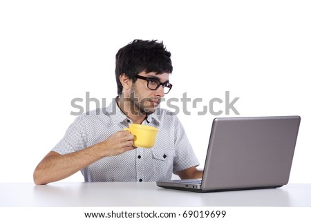 young man working and drinking coffee (isolated on white)