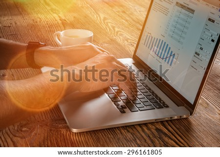 young man working from home using notebook computer